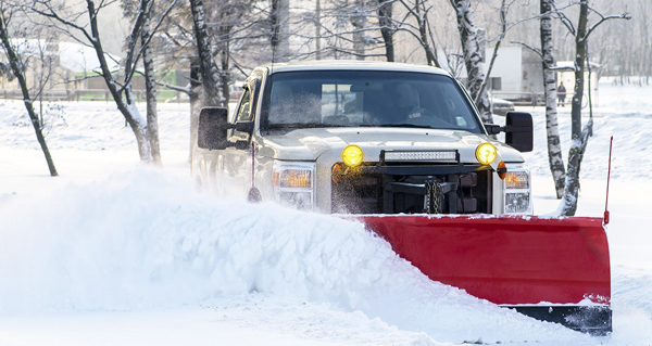 image of a pickup truck snow plowing